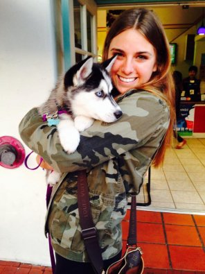 amateur photo Cute girl holding cute dog