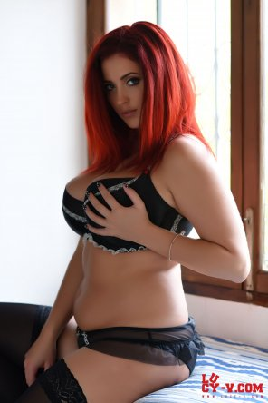 amateur photo Lucy Collett touching her bra