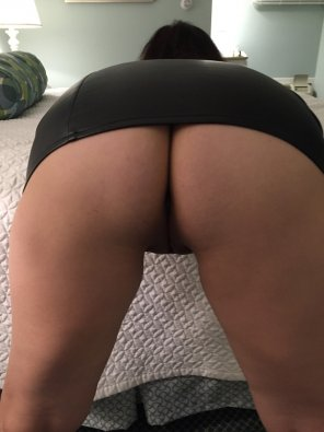 amateur photo Wife - Bent over in a leather mini-skirt