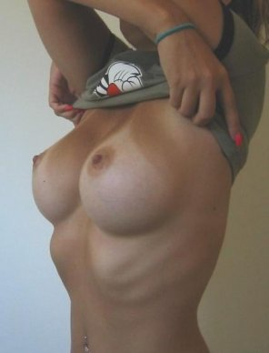 amateur photo Perky boobs with Tanlines