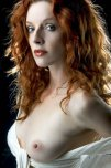 amateur photo Redhead with a boob out