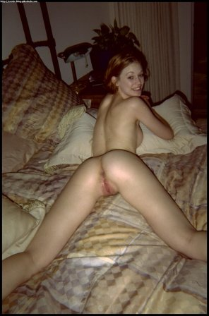 amateur photo Redhead on her bed
