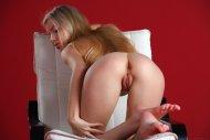 Kneeling on her chair