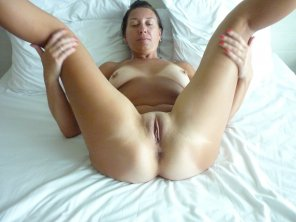 amateur photo Tanned MILF with legs up