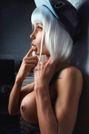 amateur photo Licking her finger.