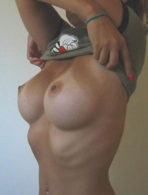 amateur photo Taking her shirt off