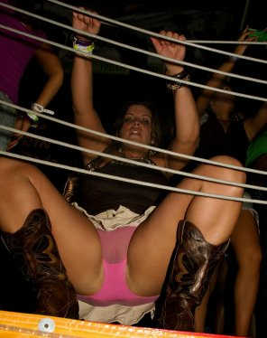 amateur photo Cowgirl flashing her hot pink panties at the dance club.