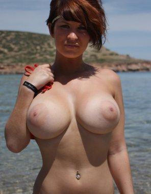 amateur photo Fixing her tan