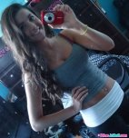 amateur photo Selfie in a tank top and yoga pants