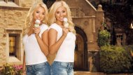 Twin blondes eating ice cream cones.