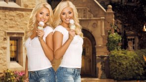 amateur photo Twin blondes eating ice cream cones.