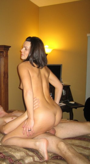 amateur photo Brunette riding hard cock