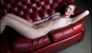 amateur photo Redhead on red couch