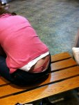 amateur photo Pink whale tail spotted on a public bench