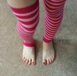Shades of Red: Here are my legs in pink striped leg warmers with a nice top view of my feet and red toenails! Enjoy!