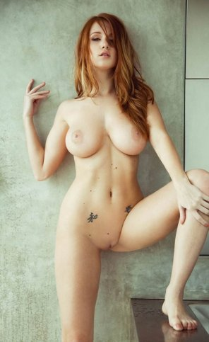 amateur photo Busty and Tattooed Redhead