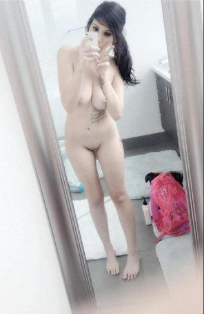 amateur photo Very sexy nude pale girl with a smooth shaved vagina take some self pictures in a bathroom