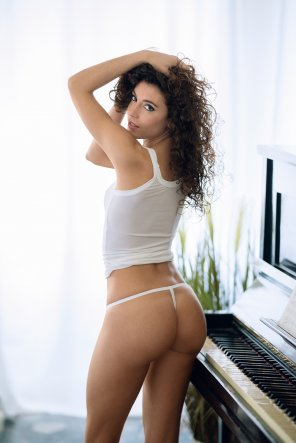 amateur photo by the piano