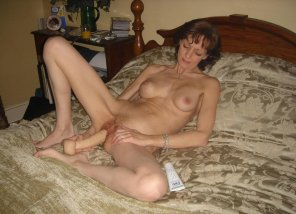 amateur photo Mature amateur uses a dildo on her hairy pussy