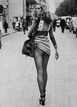 amateur photo Lifting her dress on a public street in 1971