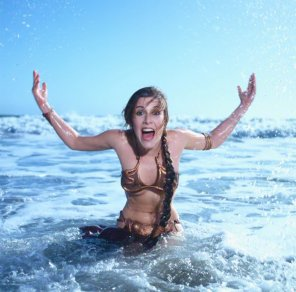 amateur photo Slavegirl Leia jumping out of the ocean, with just a bit of underboob