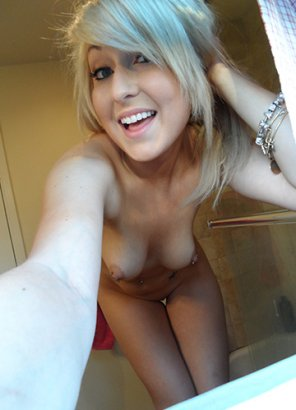 amateur photo Blonde happily showing her assets