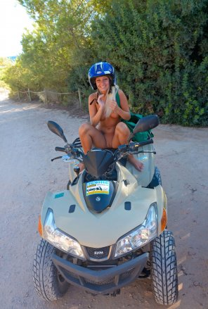 amateur photo happy/embarrassed on a quad bike