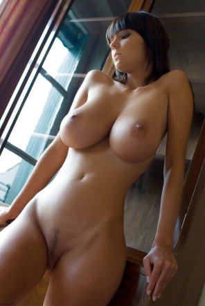 amateur photo Stunning cutey by the window