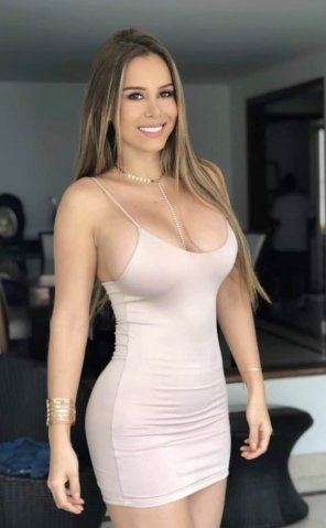 amateur photo Busty Latina in a Tight Dress