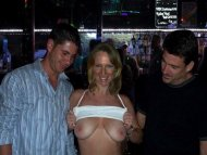 Flashing strangers her tits at the bar.