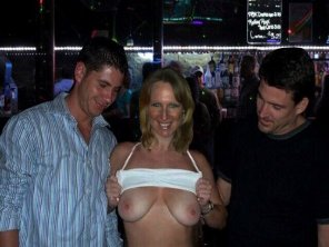 amateur photo Flashing strangers her tits at the bar.