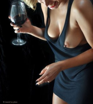 amateur photo Milf with wine and a nip slip