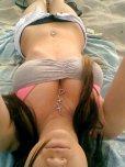 amateur photo Beach selfie taken by busty brunette.