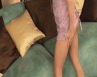 Stephanie Cane Poses On Giant Couch - scene 1