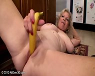 Mature Woman Plays With Banana