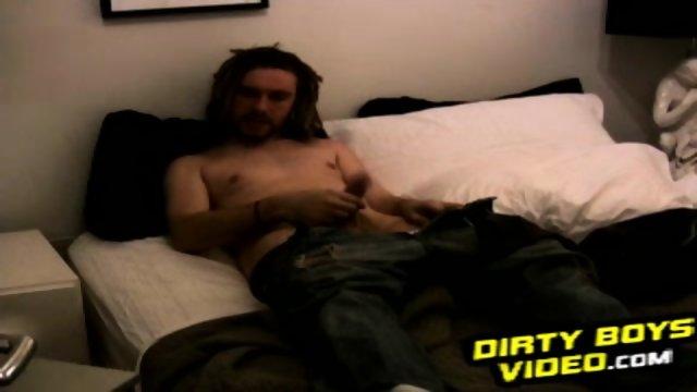 Amateur dude Rik rubs his dick in bedroom on the bed
