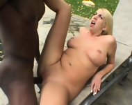 Blonde Chick Has Interracial Sex In The Garden