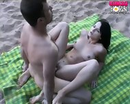 Hot Action On The Beach