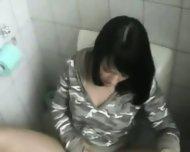 Bimbo Chick masturbates in Toilet - scene 2