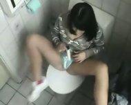 Bimbo Chick masturbates in Toilet - scene 4