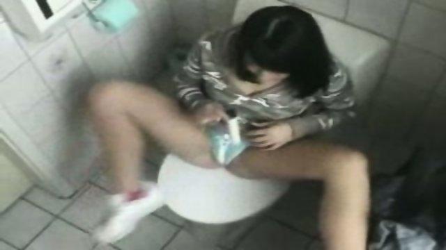 Bimbo Chick masturbates in Toilet