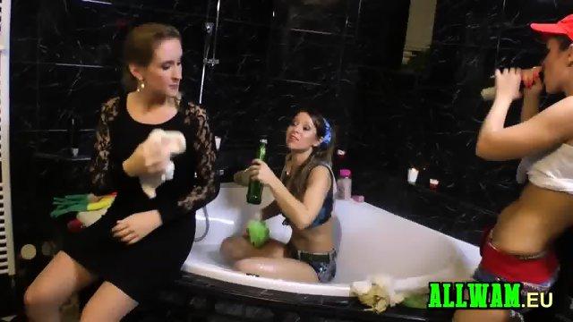 Blonde girls playing in a bathtub
