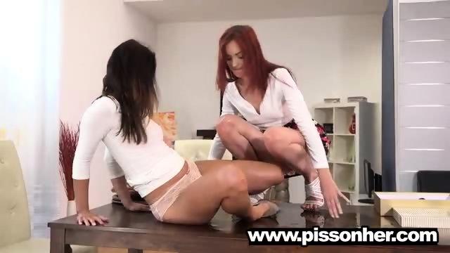 Sexy Daphne peeing next to her girlfriend