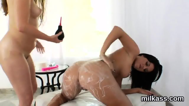 Sexy lesbos fill up their massive bootys with milk and squirt it out