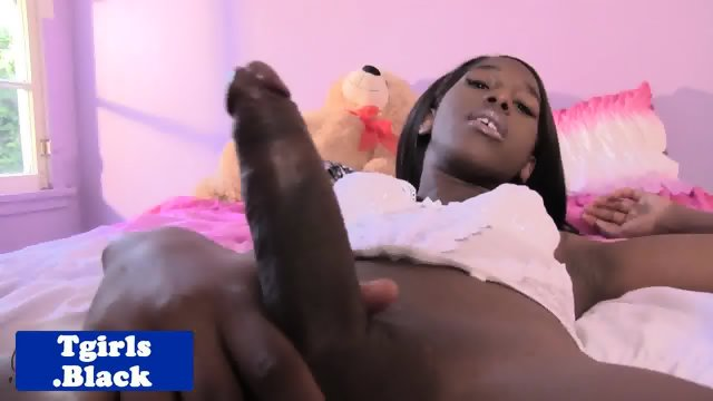 Black tgirl pulling on her throbbing cock