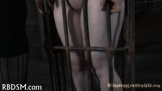 Caged up beauty needs punishment