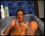 Lesbian having fun in the bath - scene 1
