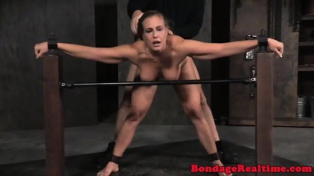 Bonded babe spitroasted by male dominators