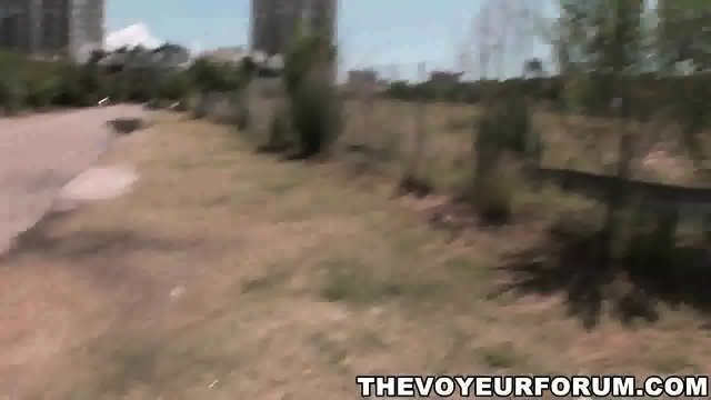 Thick brunette babe shows her ass and tits outdoors - scene 11