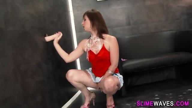 Gloryhole slut rides toy